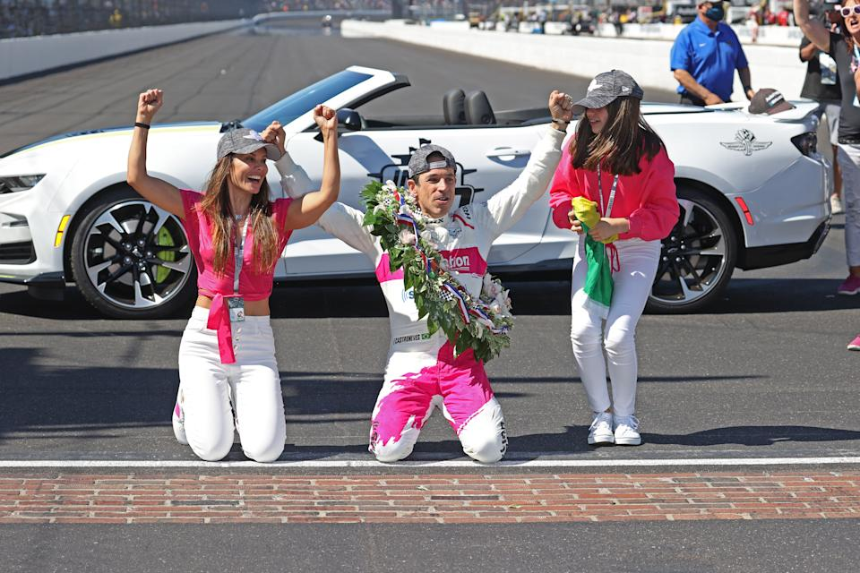 Helio Castroneves celebrates at the yard of bricks with wife, Adriana, and daughter, Mikaella, after winning the 105th running of the Indianapolis 500 on May 30, 2021. (Brian Spurlock/Icon Sportswire via Getty Images)
