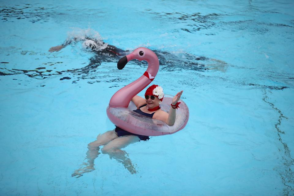 Nicole Foster swims in a rubber flamingo at Hillingdon Lido in Uxbridge, west London, on the first day of a major easing of England's coronavirus lockdown to allow far greater freedom outdoors. Picture date: Monday March 29, 2021.
