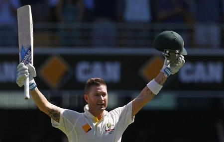 Australia's captain Michael Clarke celebrates his century during the third day's play of the first Ashes cricket test match against England in Brisbane November 23, 2013. REUTERS/David Gray