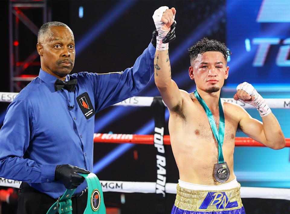 Adam Lopez celebrates after earning a 10-round majority decision over Louie Coria on June 11 at the MGM Grand Conference Center in Las Vegas. (Mikey Williams/Top Rank)