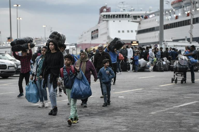 Greece is being urged to move migrants from overcrowded island camps to the mainland