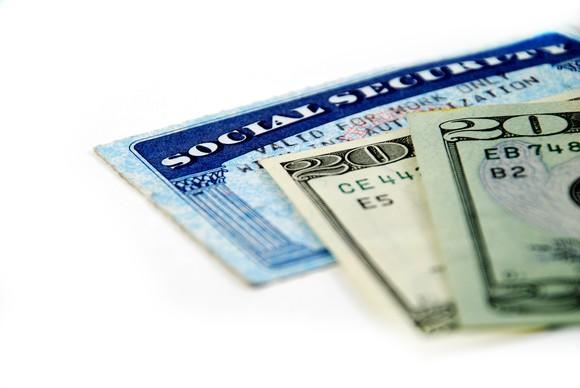 Social Security card with two 20 dollar bills on top.
