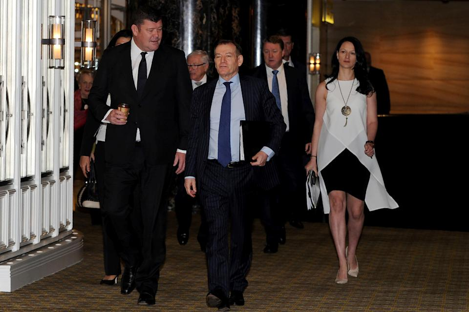 Tycoon James Packer (L) and Crown Resorts executive chairman John Alexander arrive for the Crown Resorts Annual General Meeting at Crown Towers in Melbourne on October 26, 2017.