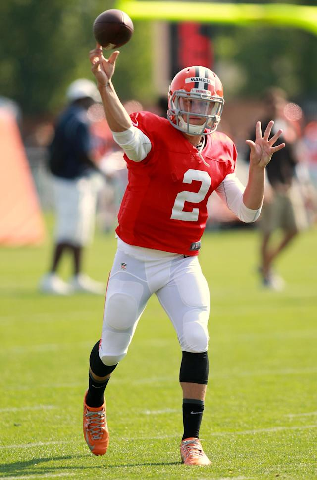Cleveland Browns quarterback Johnny Manziel (2) throws a pass at the NFL football team's training camp in Berea, Ohio,Thursday, July 31, 2014. (AP Photo/Aaron Josefczyk)