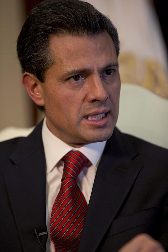 """Enrique Pena Nieto speaks during an interview with The Associated Press at the Los Pinos presidential residence in Mexico City, Monday, Dec. 10, 2012. Pena Nieto says he'll mount a """"real fight"""" against production and trafficking of marijuana, despite its legalization in two U.S. states. (AP Photo/Dario Lopez-Mills)"""