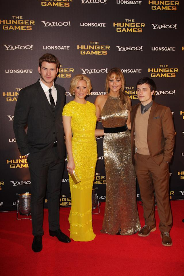 LONDON, ENGLAND - MARCH 14:  (UK TABLOID NEWSPAPERS OUT) L-R Liam Hemsworth, Elizabeth Banks, Jennifer Lawrence and Josh Hutcherson attend the European premiere of The Hunger Games at The O2 Arena on March 14, 2012 in London, England.  (Photo by Dave Hogan/Getty Images)