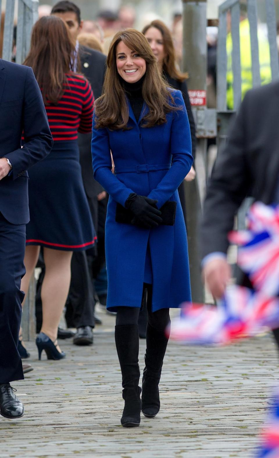 <p>For a day of events in Scotland. Kate appropriately chose Scottish designer Christopher Kane to create a bespoke royal blue coat. Her favourite heeled boots by Aquatalia finished the look as did a Stuart Weitzman clutch. </p><p><i>[Photo: PA]</i></p>
