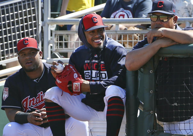FILE - In this March 18, 2019, file photo, injured Cleveland Indians shortstop Francisco Lindor, center, smiles as he watches his teammates during the first inning of a spring training baseball game against the San Diego Padres in Goodyear, Ariz. Lindor says hes ready to make his season debut after being injured. Lindor sat out Clevelands first 18 games with a sprained ankle he sustained during spring training in Arizona while recovering from an offseason calf injury. Hes expected to be in Clevelands lineup this weekend against Atlanta. (AP Photo/Ross D. Franklin, File)