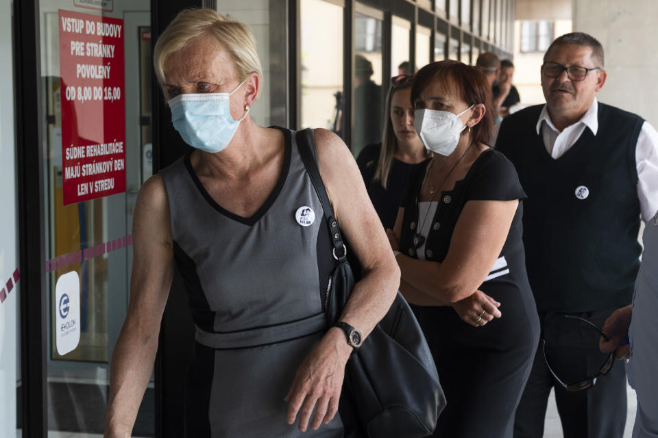 Zlatica Kusnirova, left, mother of Kuciak's fiancee Martina Kusnirova; and Jana Kuciakova and Jozef Kuciak, parents of murdered Jan Kuciak arrive at the Supreme Court in Bratislava, Slovakia, Tuesday, June 15, 2021. Slovakia's appeals court has dismissed a lower court verdict that acquitted a businessman accused of masterminding the 2018 slayings of an investigative journalist who had written about him and the journalist's fiancee. The verdict by Slovakia's Supreme Court means that the case now returns to the Specialized Criminal Court in Pezinok that ruled in September to clear the businessman, Marian Kocner, and one co-defendant of murder in the killings of journalist Jan Kuciak and his fiancee, Martina Kusnirova, both 27. (Jaroslav Novak/TASR via AP)