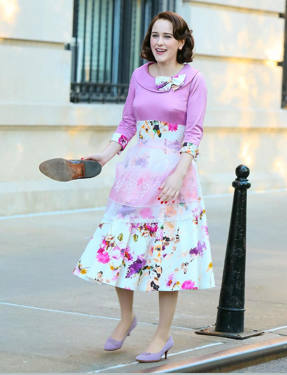 <p>Brosnahan wore a floral dress ensemble on set on May 13. </p>