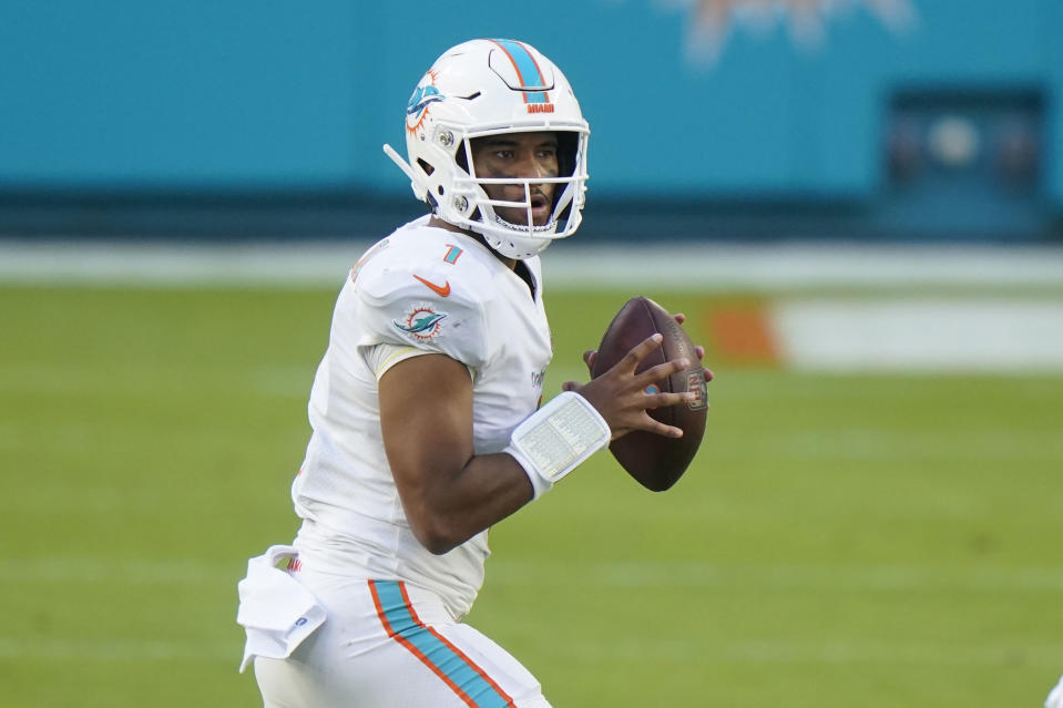 Miami Dolphins quarterback Tua Tagovailoa (1) looks to pass the ball during the second half of an NFL football game against the Los Angeles Rams, Sunday, Nov. 1, 2020, in Miami Gardens, Fla. (AP Photo/Wilfredo Lee)