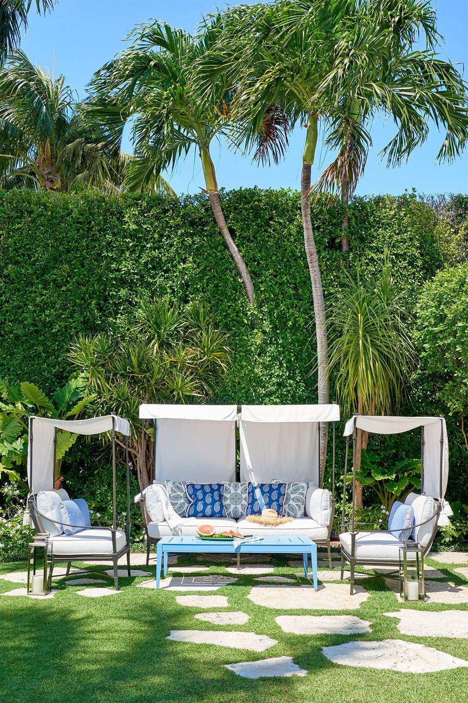 <p>Turn your backyard into a tropical oasis (well, kind of) by sticking patio furniture straight on the grass. Fill out the space with plush pillows, patterned blankets, and battery-operated lanterns.</p>