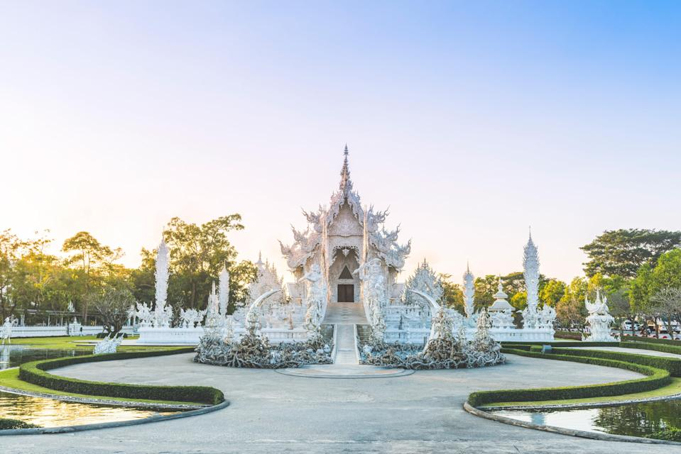This temple in Chiang Rai is one of the more recent constructions on our list, having been built by Thai artist Chalermchai Kosipipat just two decades ago in 1997. The gleaming white structure is an ode to Buddha's purity, as well as <em>samsara</em>—the cycle of birth, existence, and death. There's a sculpture of hands raising up from the earth, seemingly from the underworld, beside the bridge leading into the temple, with warrior sculptures flanking each side. But Wat Rong Khun also shows its modernity in many art installations, including nods to superheroes and aliens.