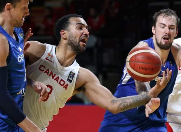 Trey Lyles, centre, can't hold on to the ball as Ondrej Balvin of the Czech Republic defends during Canada's 103-101 overtime loss at a last-gasp Olympic qualifying tournament in Victoria on Saturday. (Chad Hipolito/The Canadian Press - image credit)