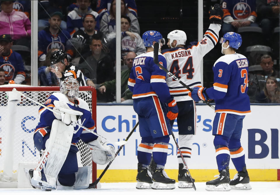 New York Islanders goaltender Semyon Varlamov (40) reacts after allowing a goal to Edmonton Oilers right wing Zack Kassian (44) who celebrates after the score during the second period of an NHL hockey game, Tuesday, Oct. 8, 2019, in Uniondale, N.Y. Islanders defenseman Ryan Pulock (6) and defenseman Adam Pelech (3) also react after Kassian's score. (AP Photo/Kathy Willens)