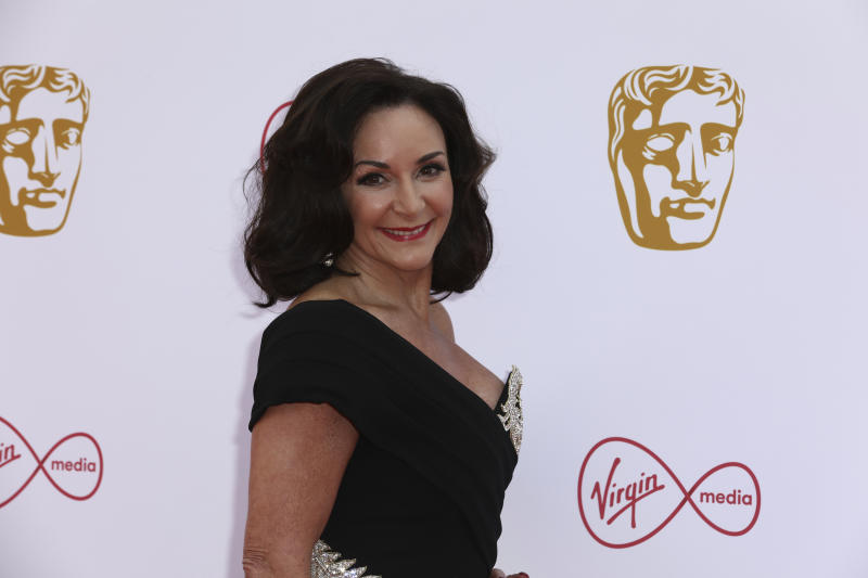 Dance Coach Dame Shirley Ballas poses for photographers on arrival at the 2019 BAFTA Television Awards in London, Sunday, May 12, 2019.(Photo by Grant Pollard/Invision/AP)