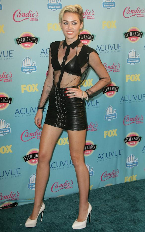 What Were You Thinking? Miley Cyrus Shocks In Teeny Leather Mini And Bra At Teen Choice Awards