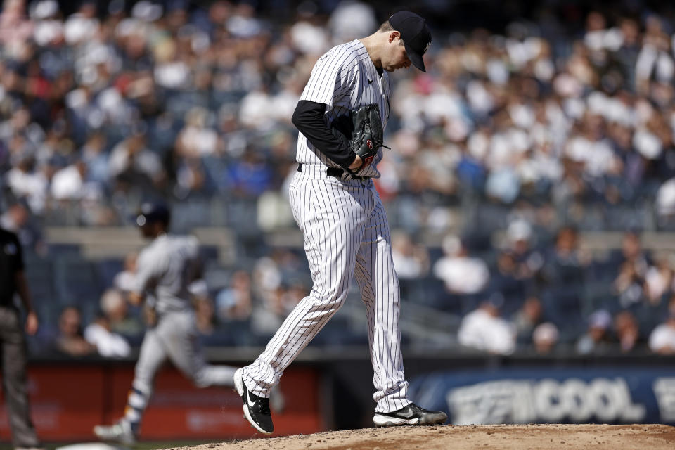 New York Yankees pitcher Jordan Montgomery reacts after giving up a three-run home run to Tampa Bay Rays' Brandon Lowe during the third inning of a baseball game on Saturday, Oct. 2, 2021, in New York. (AP Photo/Adam Hunger)