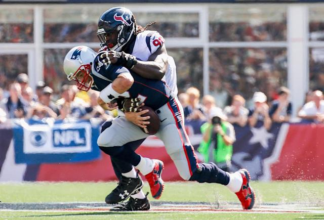 <p>Tom Brady #12 of the New England Patriots is sacked by Jadeveon Clowney #90 of the Houston Texans during the second quarter of a game at Gillette Stadium on September 24, 2017 in Foxboro, Massachusetts. (Photo by Jim Rogash/Getty Images) </p>