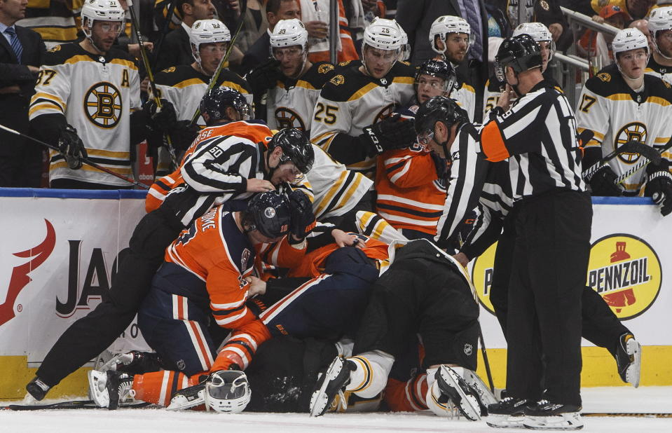 Boston Bruins' and the Edmonton Oilers' get into a brawl during third period NHL hockey action in Edmonton, Alberta, Thursday Oct. 18, 2018. (Jason Franson/The Canadian Press via AP)