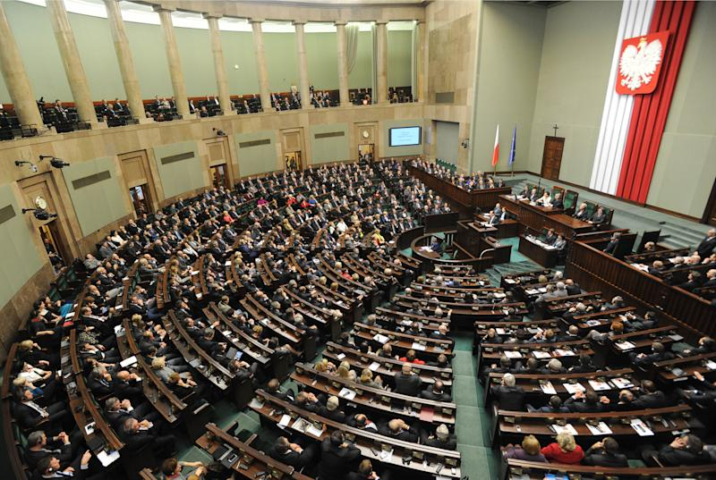 FILE This Friday, Nov. 16, 2012 file photo shows a general view of the Polish parliament as visiting French President Francois Hollande addresses lawmakers in Warsaw, Poland. Polish authorities said Tuesday Nov. 20, 2012 that they have arrested a man who was planning to carry out a terror attack on the Parliament building in Warsaw while the president, prime minister, government ministers and lawmakers were inside. Prosecutors said Tuesday that they arrested the suspect in Krakow on Nov. 9. They say he is a 45-year-old Polish academic researcher who had access to chemistry laboratories and who was in illegal possession of explosive materials, munitions and guns.   (AP Photo/Alik Keplicz)