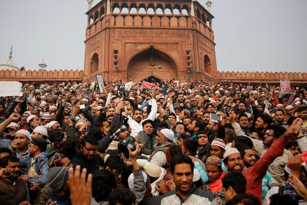 Dalit leader and Bhim Army founder Chandrashekhar Azad join others for a protest against the Citizenship Amendment Act after Friday prayers outside Jama Masjid in New Delhi, Dec. 20, 2019.