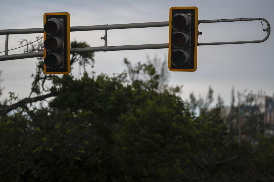 Traffic signal lights are not working as a result of selective blackouts, in San Juan, Puerto Rico, Thursday, Sept. 30, 2021. Power outages across the island have surged in recent weeks, with some lasting up to several days. (AP Photo/Carlos Giusti)