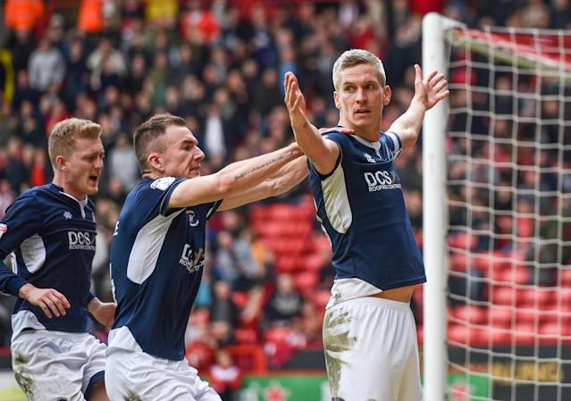 "Soccer Football - Championship - Sheffield United vs Millwall - Bramall Lane, Sheffield, Britain - April 14, 2018 Millwall's Steve Morison celebrates scoring their first goal with team mates Action Images/Paul Burrows EDITORIAL USE ONLY. No use with unauthorized audio, video, data, fixture lists, club/league logos or ""live"" services. Online in-match use limited to 75 images, no video emulation. No use in betting, games or single club/league/player publications. Please contact your account representative for further details."