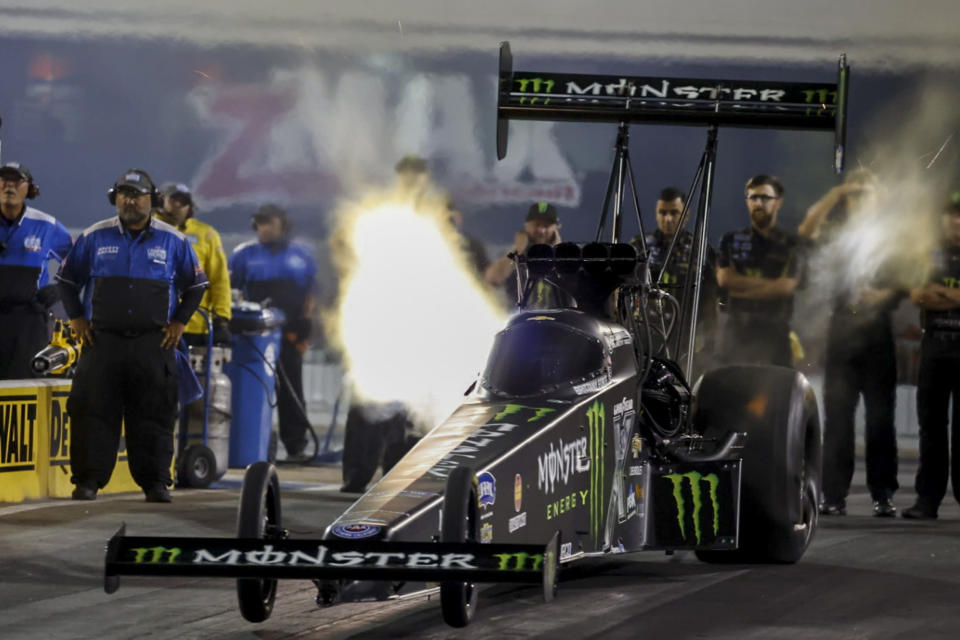 In this photo provided by the NHRA, Top Fuel's Brittany Force races to the provisional No. 1 position in her first-round qualifying run in her Monster Energy dragster at the DeWalt NHRA Carolina Nationals at zMAX Dragway in Concord, N.C., Friday, Sept. 17, 2021. (Randy Anderson/NHRA via AP)