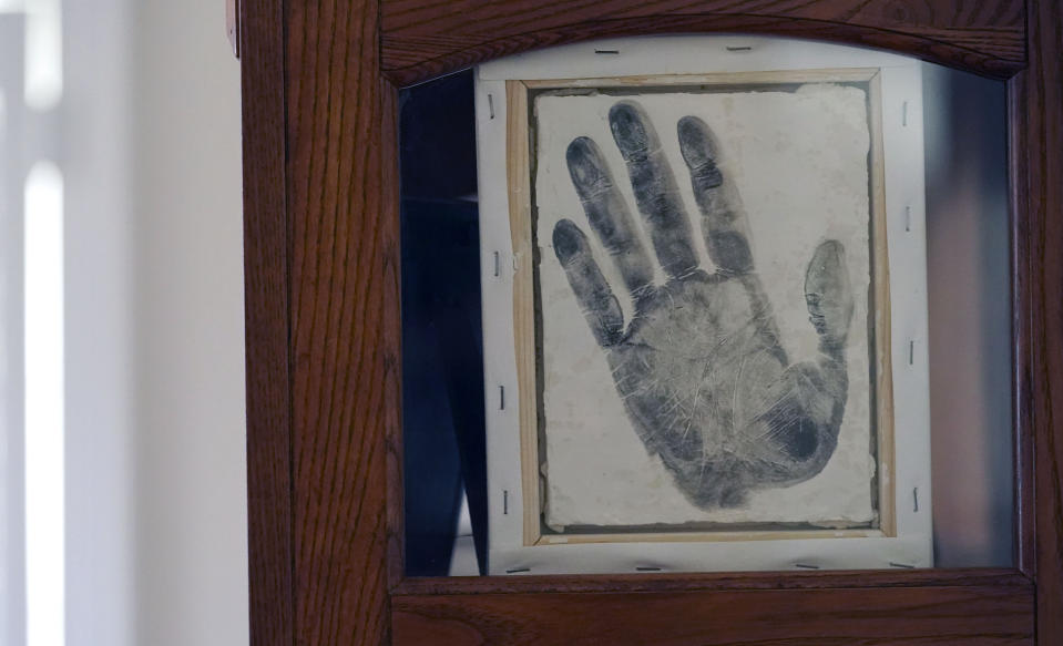 A handprint of Tyrell Wilson, who was shot and killed by a California police officer in March, is displayed at the home of his father, former U.S. Marine and retired law enforcement officer Marvin Wilson in Fort Worth, Texas, May 17, 2021. Tyrell Wilson was shot and killed by Officer Andrew Hall in the San Francisco Bay Area, just weeks before prosecutors charged the same officer with manslaughter and assault in the fatal shooting of an unarmed Filipino man more than two years earlier. Wilson's father said an emergency room nurse took the handprint of his son. (AP Photo/LM Otero)