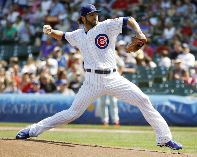 Chicago Cubs starting pitcher Jake Arrieta pitches against the Philadelphia Phillies during the first inning of a baseball game on Sunday, Sept. 1, 2013, in Chicago. (AP Photo/Andrew A. Nelles)