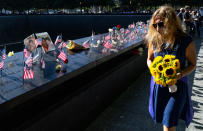 Flags adorn the inscribed names of the victims of Sept. 11, 2001, at the National September 11 Memorial in New York on the 20th anniversary of the attacks, Saturday, Sept. 11, 2021. (Craig Ruttle/Newsday via AP, Pool)