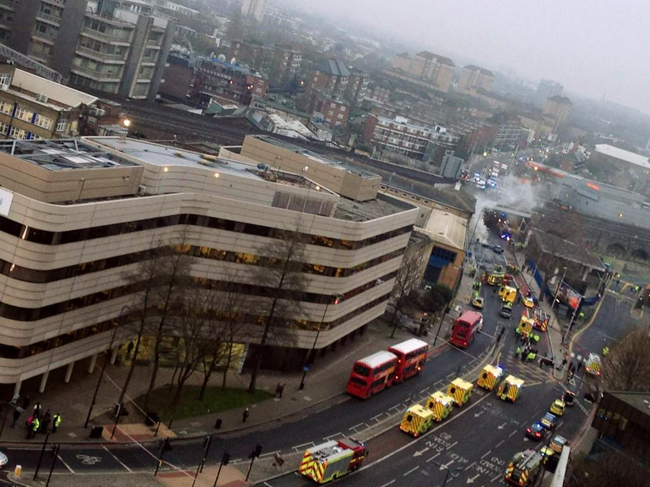 LONDON, UNITED KINGDOM - JANUARY 16: (BEST QUALITY AVAILABLE)  Emergency services building arrive as smoke pours from the burning debris of a helicopter which crashed in the Vauxhall area, January 16, 2013 in London, England.  The helicopter appeared to hit a crane attached to the nearby St Georges Wharf Tower before plunging  into the road below during the morning rush hour.   (Photo by Victor Jimenez/Getty Images)