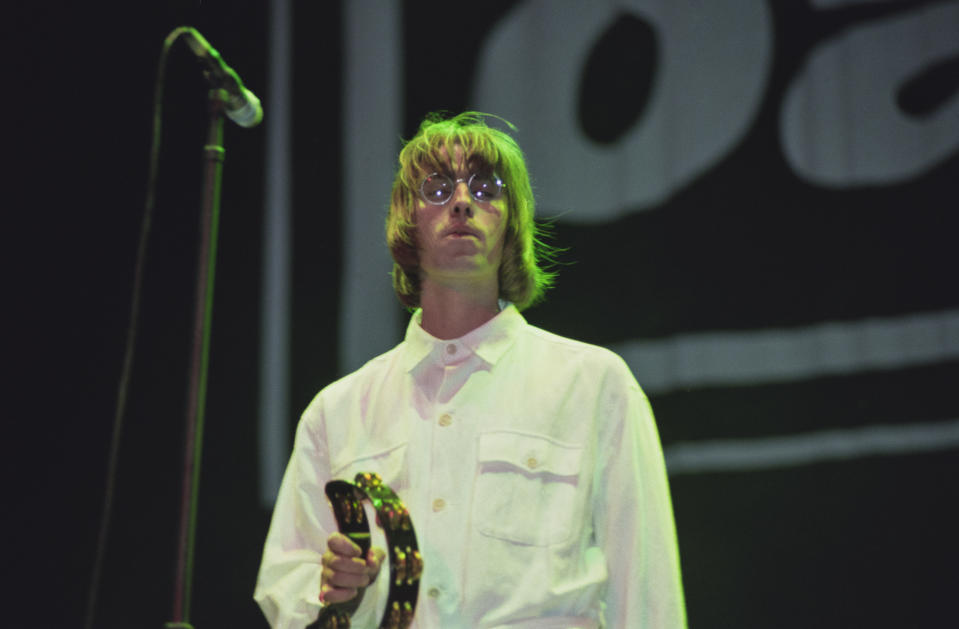 Singer Liam Gallagher performing with British rock group, Oasis, at Knebworth House, Hertfordshire, 10th August 1996. (Photo by Brian Rasic/Hulton Archive/Getty Images)