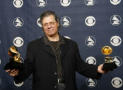 FILE - Chick Corea is photographed with his awards at the 49th Annual Grammy Awards on Feb. 11, 2007, in Los Angeles. He won from best jazz instrumental and best instrumental arrangement. Corea, a towering jazz pianist with a staggering 23 Grammy awards who pushed the boundaries of the genre and worked alongside Miles Davis and Herbie Hancock, has died. He was 79. Corea died Tuesday, Feb. 9, 2021, of a rare for of cancer, his team posted on his web site. His death was confirmed by Corea's web and marketing manager, Dan Muse. (AP Photo/Kevork Djansezian, File)