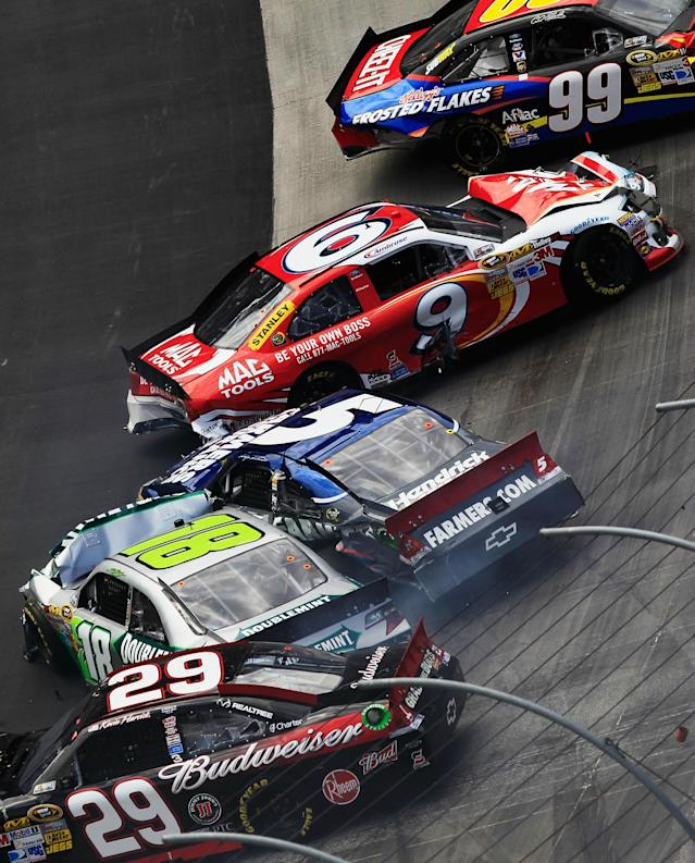 BRISTOL, TN - MARCH 18: Carl Edwards, driver of the #99 Cheez-It Ford, Marcos Ambrose, driver of the #9 Mac Tools Ford, Kasey Kahne, driver of the #5 Farmers Insurance Chevrolet, Kyle Busch, driver of the #18 Wrigley Toyota, and Kevin Harvick, driver of the #29 Budweiser Chevrolet, are involved in an incident during the NASCAR Sprint Cup Series Food City 500 at Bristol Motor Speedway on March 18, 2012 in Bristol, Tennessee. (Photo by Chris Trotman/Getty Images)