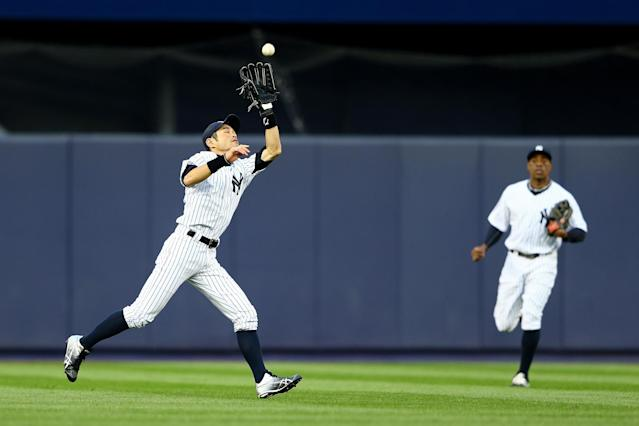 NEW YORK, NY - OCTOBER 12: Ichiro Suzuki #31 of the New York Yankees makes a catch in the outfield against the Baltimore Orioles during Game Five of the American League Division Series at Yankee Stadium on October 12, 2012 in New York, New York. (Photo by Al Bello/Getty Images)