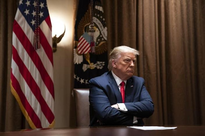President Donald Trump listens during a meeting with Hispanic leaders in the Cabinet Room of the White House, Thursday, July 9, 2020, in Washington. (AP Photo/Evan Vucci)