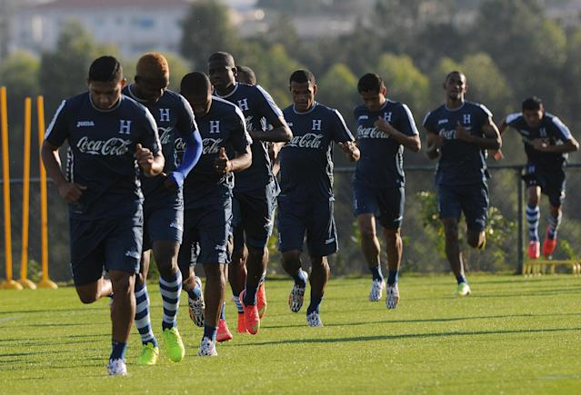 Honduras' national team players run during a training session of the Honduran national soccer team, in Porto Feliz, Brazil, Sunday, June 22, 2014. Languishing in bottom spot in Group E after two defeats, Honduras has only a very slim chance of qualifying for the knockout stages of the World Cup. (AP Photo/Fernando Antonio)