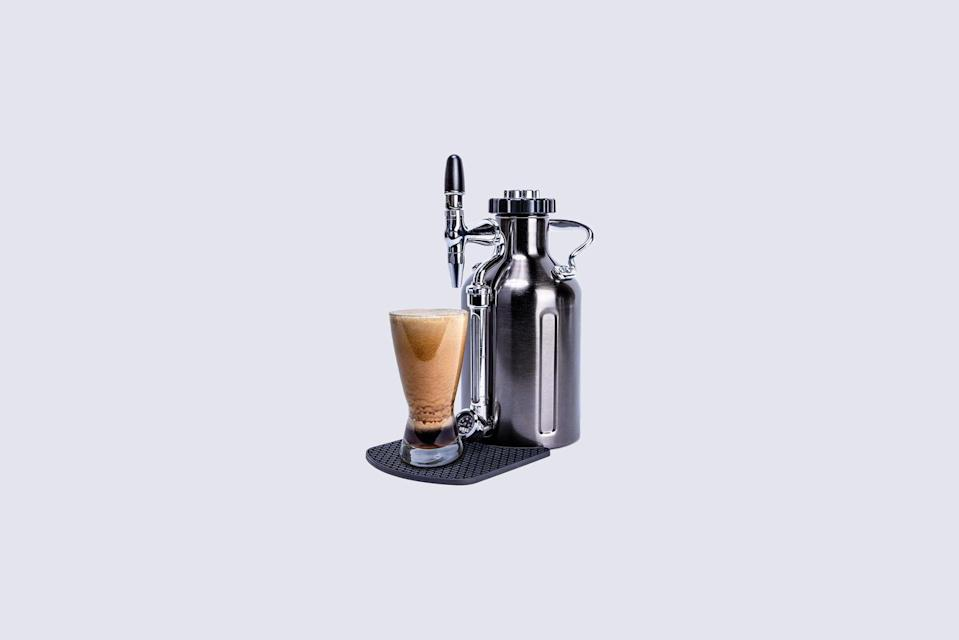 """<p>Talk about cool beans! This <a href=""""https://www.youtube.com/watch?v=wHyr6FdKtzY"""" rel=""""nofollow noopener"""" target=""""_blank"""" data-ylk=""""slk:cold-brew coffee"""" class=""""link rapid-noclick-resp"""">cold-brew coffee</a> maker has a Nitro pressurization system and a Nitro tap that turbulates for a cascading pour and rich, creamy texture. It also does double duty, storing the java in a dispenser with stainless-steel vacuum insulation that keeps it cold all day.</p> <p><strong><em>Buy Now</em></strong><em>: GrowlerWerks Ukeg Nitro Cold Brew Maker, $199, <a href=""""https://www.growlerwerks.com/products/ukeg-nitro-cold-brew-coffee-maker"""" rel=""""nofollow noopener"""" target=""""_blank"""" data-ylk=""""slk:growlerwerks.com"""" class=""""link rapid-noclick-resp"""">growlerwerks.com</a>.</em></p>"""