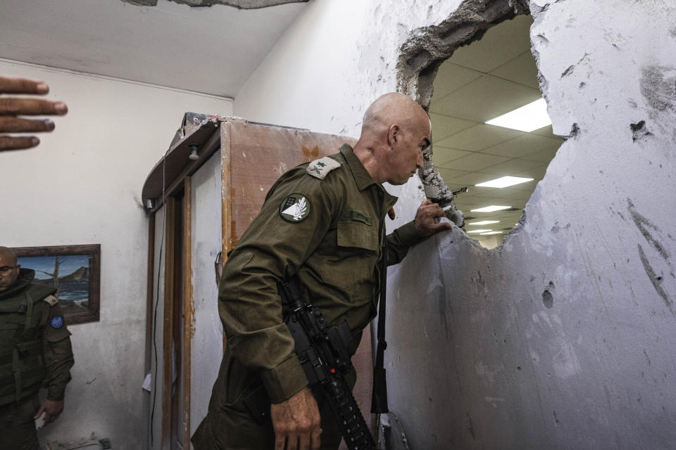 An Israeli army officer inspects a damaged synagogue after it was hit by a rocket fired from the Gaza Strip, in Ashkelon, Israel, Sunday, May 16, 2021. (AP Photo/Tsafrir Abayov)
