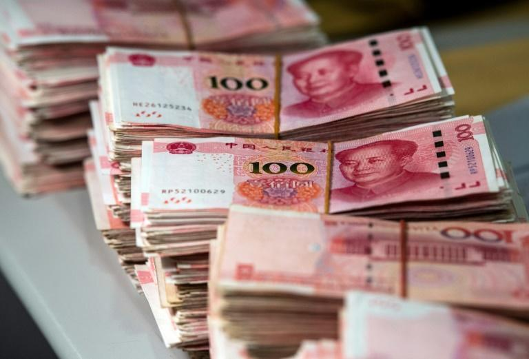 The IMF said China should allow its currency to respond freely to factors including new US tariffs to absorb the shock (AFP Photo/Johannes EISELE)