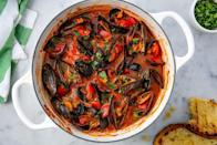 """<p>There's something about dining on mussels that feels decadent and festive for the holidays. Even better, the colors of this dish just scream <em>Christmas</em>, thanks to bright-red sauce and a fresh parsley garnish. Essential: Don't forget some crunchy bread for dipping.</p><p><em><a href=""""https://www.delish.com/cooking/recipe-ideas/recipes/a54228/steamed-mussels-recipe-2/"""" rel=""""nofollow noopener"""" target=""""_blank"""" data-ylk=""""slk:Get the recipe from Delish »"""" class=""""link rapid-noclick-resp"""">Get the recipe from Delish »</a></em></p>"""