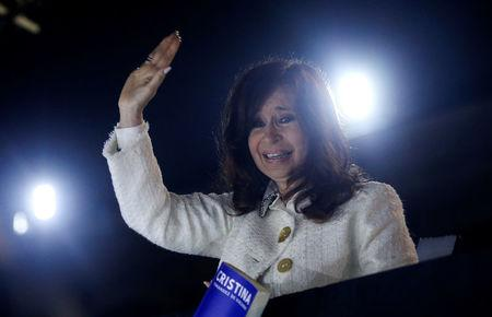 "Argentina's former President Cristina Fernandez de Kirchner waves to supporters after the presentation of her book ""Sinceramente"", at the Buenos Aires book fair"