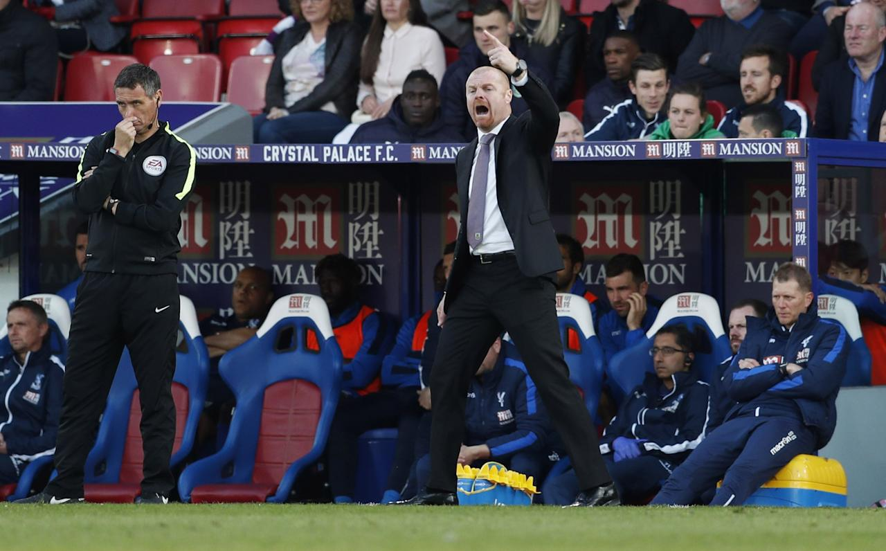 <p>Burnley manager Sean Dyche celebrates after the game </p>