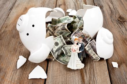 Money falling out of piggy bank with newlywed figure