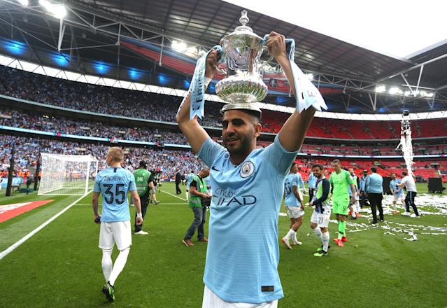 Riyad Mahrez celebrates with the FA Cup trophy. (Photo by Victoria Haydn/Man City via Getty Images)