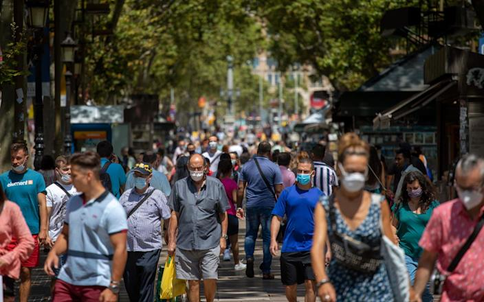 Las Ramblas, Barcelona, full with people this week - AP