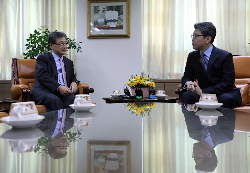 US State Department's Special Representative for North Korea Policy Joseph Yun (L) talks with South Korea's Special Representative for Korean Peninsula Peace and Security Affairs Kim Hong-kyun in 2016