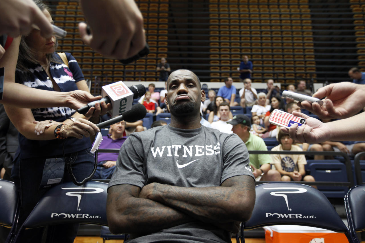 U.S. men's national basketball team forward LeBron James pauses during a media availability before a practice, Sunday, July 15, 2012, in Washington. (AP Photo/Alex Brandon)